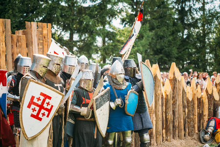 crusaders: Dudutki, Belarus - July19, 2014: Historical restoration of knightly fights on festival of medieval culture. The siege of wooden fortress