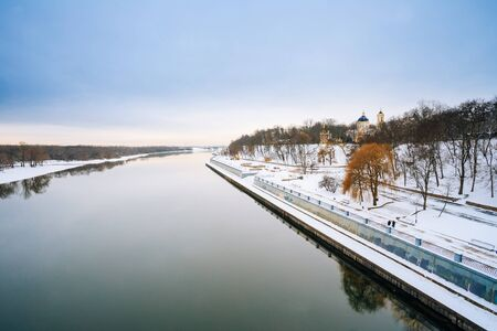 Sozh river embankment near the Palace and Park Ensemble in Gomel, Belarus. Peter and Paul Cathedral. Winter season