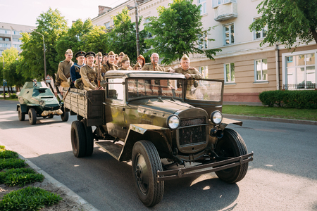 ww2: Gomel, Belarus - May 9, 2016: Russian Soviet Military Truck ZIS-5V Of WW2 Time With Group People In Soldiers Uniform And Weapon On Board Moving On The Street To Take Part At Victory Day Parade 9 May Editorial