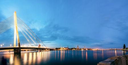 Vansu Bridge , formerly Gorky Bridge, In Riga, Latvia. Shroud Bridge. Summer Evening With Blue Sky. 595 Meters In Length. Vansu Bridge - One Of The Symbols Of Modern Riga. Crossing The Daugava River