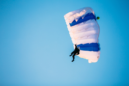 parachute jump: Single Skydiver On Parachute In Blue Clear Sky. Active Lifestyle, Extreme Hobbies