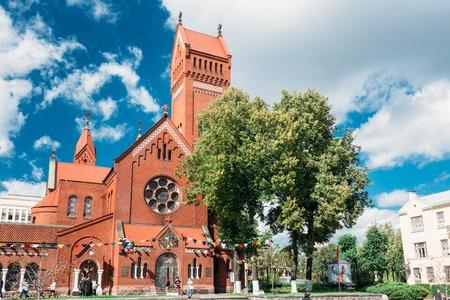 helen: Minsk, Belarus - August 27, 2014: Belarussian Catholic Church Of Saints Simon And Helen - Red Church On Independence Square In Minsk, Belarus