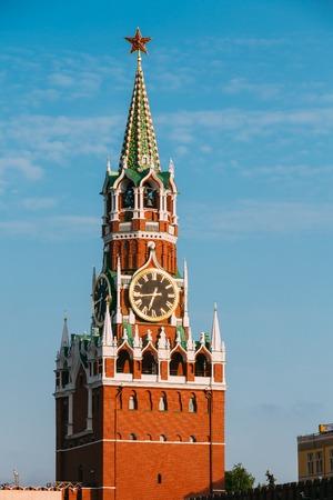 spasskaya: Spasskaya Tower Of Kremlin On Red Square In Moscow, Russia. Blue Sky Background