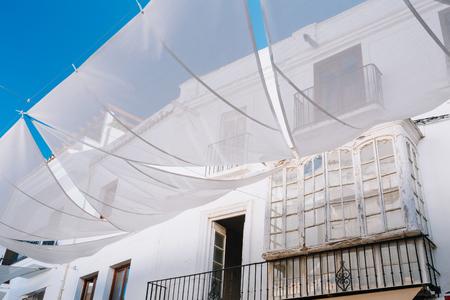 nerja: Old Architecture In Narrow Streets In Nerja, Spain. White Balcony