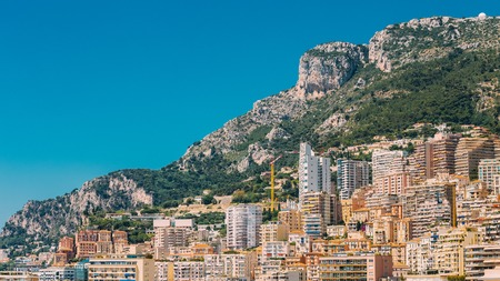 multistory: Monaco, Monte Carlo Architecture On Mountain Hill Background. Many Multi-story Houses, Buildings.