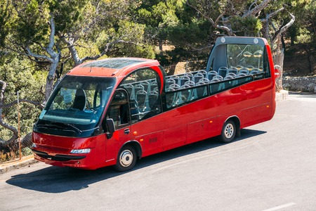 open topped: Red Touristic Bus On Street. Touristic Bus Service That Shows The City. Stock Photo