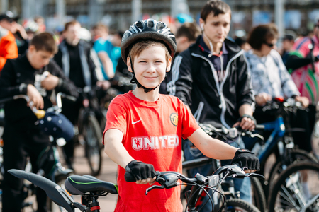 Gomel, Belarus - April 10, 2015: Boy at opening of the cycling season in the city