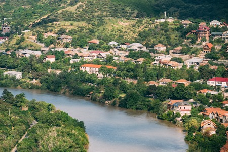 uptown: The Scenic Top View Of Mtskheta, Georgia. The Residential Area Along Bank Of The Aragvi River In Summer Sunny Day.