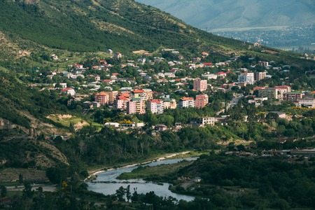uptown: The Scenic View Of Mtskheta, Georgia. Uptown, The Residential Area On Green Hillside By The Mountain River In Summer Sunny Day.