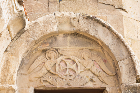 glorification: Mtskheta, Georgia. Close View Of Bas-Relief Glorification Of The Cross Crowning The Entrance To The Ancient Jvari Monastery, Georgian Orthodox Church Of Holly Cross, World Heritage By Unesco.
