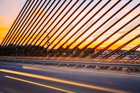 shrouds: Shrouds Of Vansu Bridge, formerly Gorky Bridge, In Riga, Latvia. Shroud Bridge. Summer Evening With Blue. 595 Meters In Length. Vansu Bridge - One Of The Symbols Of Modern Riga Stock Photo