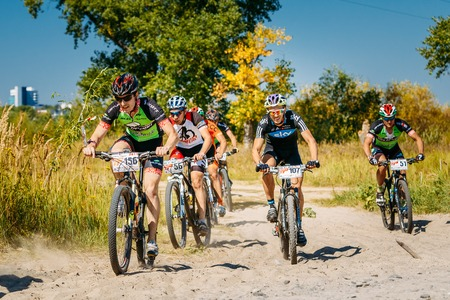 Gomel, Belarus - August 9, 2015: Group of mountain bike cyclists riding track at sunny day, healthy lifestyle active athlete doing sport. Editorial