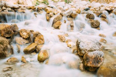 nerja: Rio Chillar River In Nerja, Malaga, Spain. Flowing Water Washes Stones. Long Exposure. Stock Photo