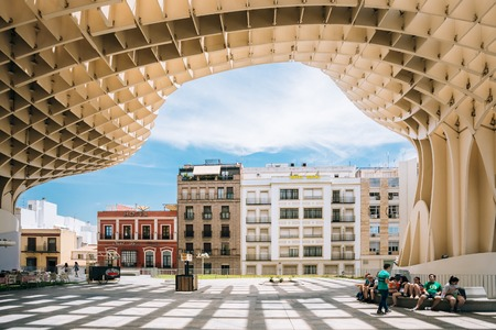 incarnation: Seville, Spain - June 24, 2015: Metropol Parasol is a wooden structure located Plaza de la Encarnacion square, in old quarter of Seville, Spain