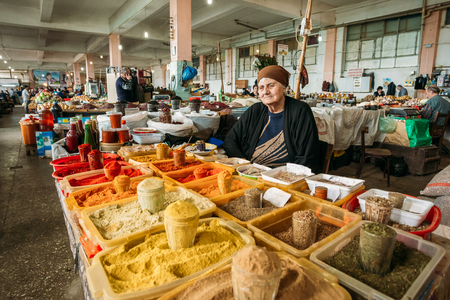Batumi, Georgia - May 28, 2016: The Elderly Georgian Woman, The  Seller Of Aromatic Varicolored Spices Is Waiting For The Buyers At The Counter Of Covered Market Bazar. Editorial