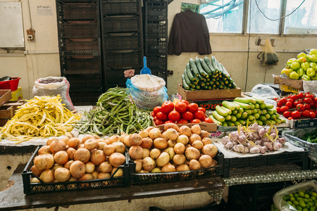 Batumi, Georgia - May 28, 2016: The Counter With Agricultural Produced: Onion, Beans, Tomatoes, Zucchini, Garlic For Sale At The Covered Market Bazar. Editorial
