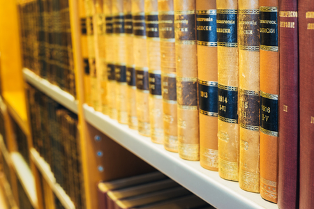 Helsinki, Finland. The Old Retro Russian  Books In Vintage Hardcovers Exposed On The Shelfs Of The National Library In Finnish Capital.