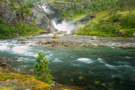 hardanger: Beautiful Waterfall In The Valley Of Waterfalls In Norway. Husedalen Waterfalls Were A Series Of Four Giant Waterfalls In The South Fjord. Stock Photo