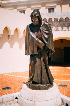 Monte-Carlo, Monaco - June 28, 2015: Statue of Francois Grimaldi disguised as a monk with a sword under his frock before the Princes Palace of Monaco Editorial