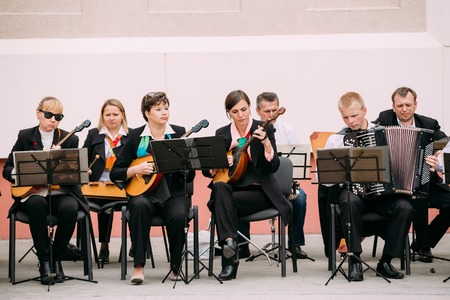 Gomel, Belarus - September 12, 2015: People from city string band Orchestra playing music on street Editorial