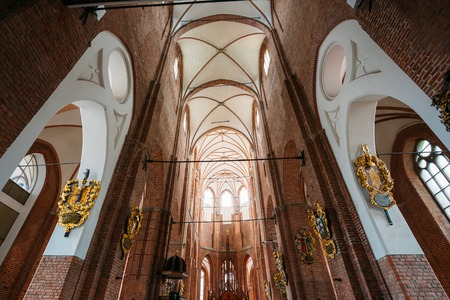 the vaulted: Riga, Latvia - July 1, 2016: The Gothic Ornate Vaulted Ceiling And Brick Walls With The Emblems Of The Interior Of St. Peters Evangelical Lutheran Church, The Parish Place And Famous Landmark. Editorial