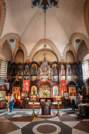 Vilnius, Lithuania - July 04, 2016: The Iconostasis And Church Interior Of Christian Orthodox Church Of Saint Nicholas With Parishioners. Editorial