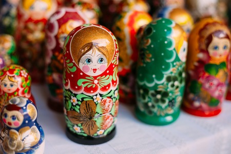 russian nesting dolls: Close View Of The Colorful Matryoshka, The Traditional Russian Nesting Dolls, The Famous Old Wooden Souvenir At The Showcase. Stock Photo