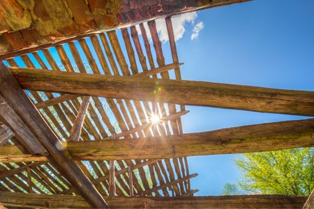 chernobyl: Sunrays Through Wooden Destroyed Roof Of Abandoned Rural House In Deserted Exclusion Area After Chernobyl Catastrophe.