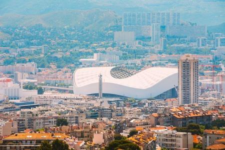 velodrome: Cityscape of Marseille, France. Urban background with sport Velodrome stadium. Stade Velodrome.
