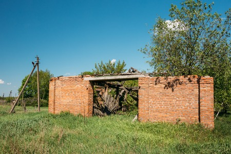The Ruined Brick Building In The Exclusion Rural Area After Chernobyl Catastrophe. The Consequences Of The Nuclear Pollution Stock Photo
