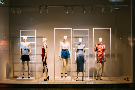 clothing shop: Vilnius, Lithuania - July 08, 2016: Five Mannequins Standing In Store Window Display Of Womens Casual Clothing Shop In Acropolis Shopping Mall.