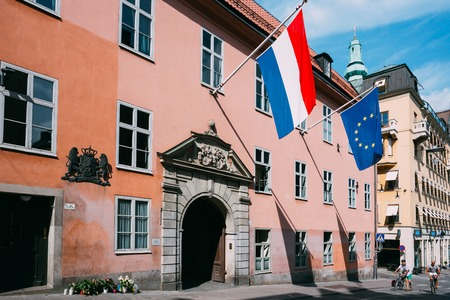 Stockholm, Sweden - July 29, 2014: French Tricolours Flag And Flag Of The European Union Decorate Building Of The Streets Of Stockholm, Sweden Editorial