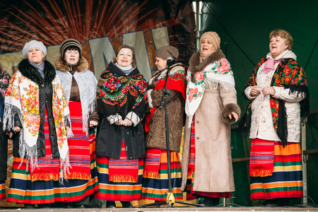 slavs: GOMEL, BELARUS - February 21, 2014: Unknown women group in national clothes at Celebration of Maslenitsa - traditional Russian holiday dedicated to the approach of spring - Slavic celebration Shrovetide.