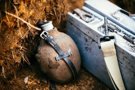 reenactmant: German military ammunition of World War II on ground. Flask, box of ammunition.