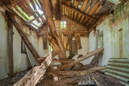 caved: Chernobyl Disaster. The Interior Of Ruined Abandoned Private Country House With Caved Roof In Exclusion Area After Terrible Consequences Of The Nuclear Contamination.