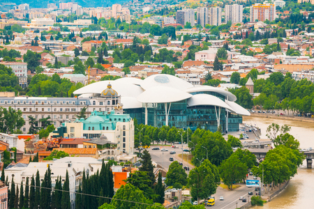 Cityspape And Top View Of Justice House, The Fufuturistic Ultramodern Building Forehead, Overlooks The Kura River. The Biggest Public Service Center Hall For Population Of Georgia, Tbilisi. Stock Photo