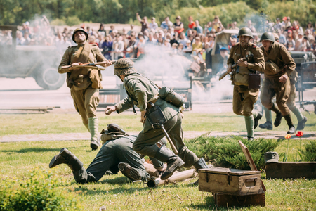 Gomel, Belarus - May 9, 2016: The Scene Of Reenactment Of The Battle Of WW2: Soviet Armed Forces Against Wehrmacht Soldiers Reenactors On Celebrating Victory Day 9 May Editorial