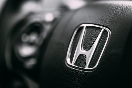 Borgund, Norway - August 1, 2014: Honda Black Steering Wheel And Silver Logo. Honda Motor Co., Ltd. is a Japanese public multinational conglomerate corporation. Redactioneel