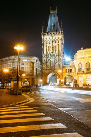 Night View Of The Powder Tower Or Powder Gate. This Landmark Is A Gothic Tower In Prague, Czech Republic. It Is One Of The Original City Gates, Dating Back To The 11th Century.