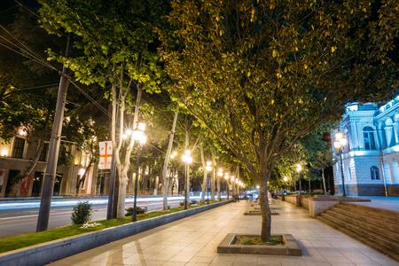 rustaveli: Tbilisi Georgia. The View Of Deserted Illuminated Pedestrian Platanus Alley On Rustaveli Avenue In Summer Evening. Stock Photo