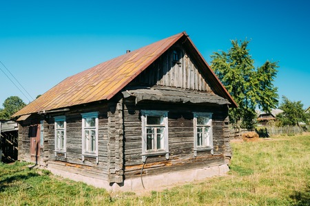 Old Russian Traditional Wooden House In Village Of Belarus Or Ru