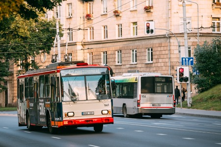 trackless: Vilnius, Lithuania. Two City Trolleybuses Moving On Wide Street