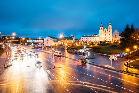 minsk: Panorama With Night Traffic On Illuninated Street And  Cathedral Editorial
