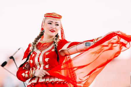 azerbaijani: Young woman dressed in traditional folk costume dancing Azerbaijani