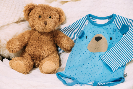 rompers: Toy Bear Near Childs Clothes Rompers.