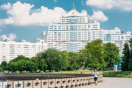 People walking along the the riverside promenade in district Nemiga