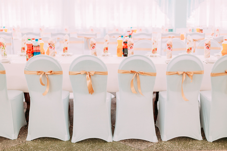 mantles: Decorative White Mantles And Colored Ribbons On Chairs At Festive Table