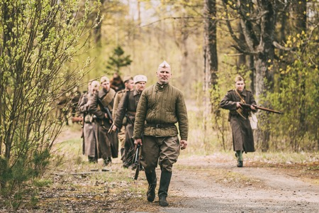 world war ii: Group Of Unidentified Re-enactors Dressed As Soviet Russian Red Army