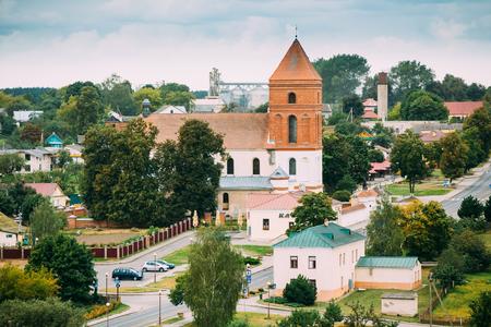 saint nicolas: Mir, Belarus. Landscape Of Village Houses And Saint Nicolas Roman Catholic Church In Mir, Belarus. Famous Landmark.