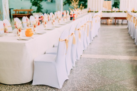 mantles: Decorative White Mantles And Colored Ribbons On Chairs At Festive Table. Stock Photo